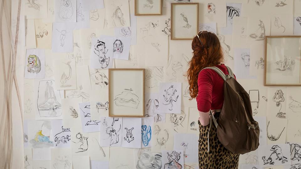 A woman looking at drawings