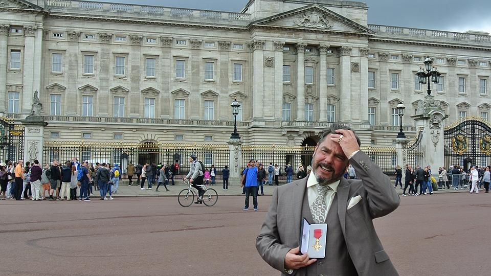Joe Baden collects his OBE at Buckingham Palace