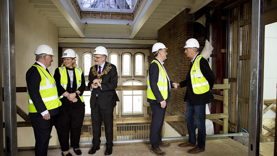 Patrick Loughrey, Sarah McCrory, Sir Steve Bullock, Andrew Macpherson, Richard Noble look around the new building