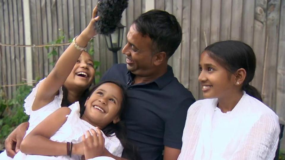 An image of interviewee Aminul Hoque and his three daughters, laughing