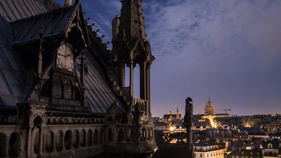 The spire of Notre-Dame cathedral at night