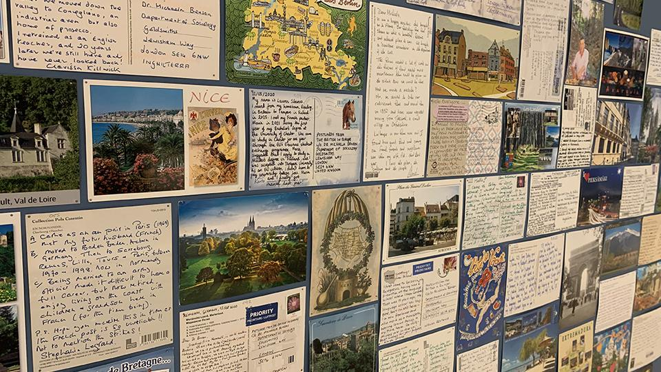 A close-up image of part of the postcards exhibition at the Migration Museum, showing a collage of letters and photographs