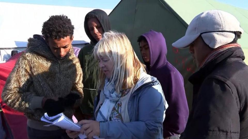 Professor Sue Clayton talks to asylum seekers in the Calais Jungle refugee camp.