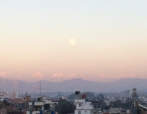 Photo of a full moon over the city of Kathmandu