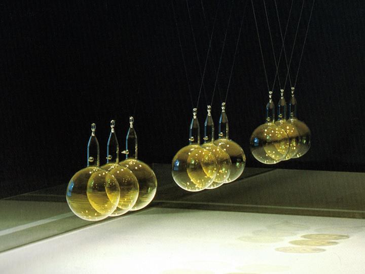Glass pendulumns floating on wires
