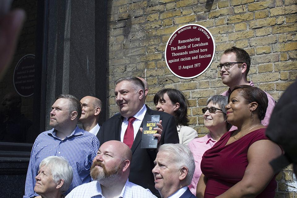 Members of Lewisham Council are photographed by the plaque