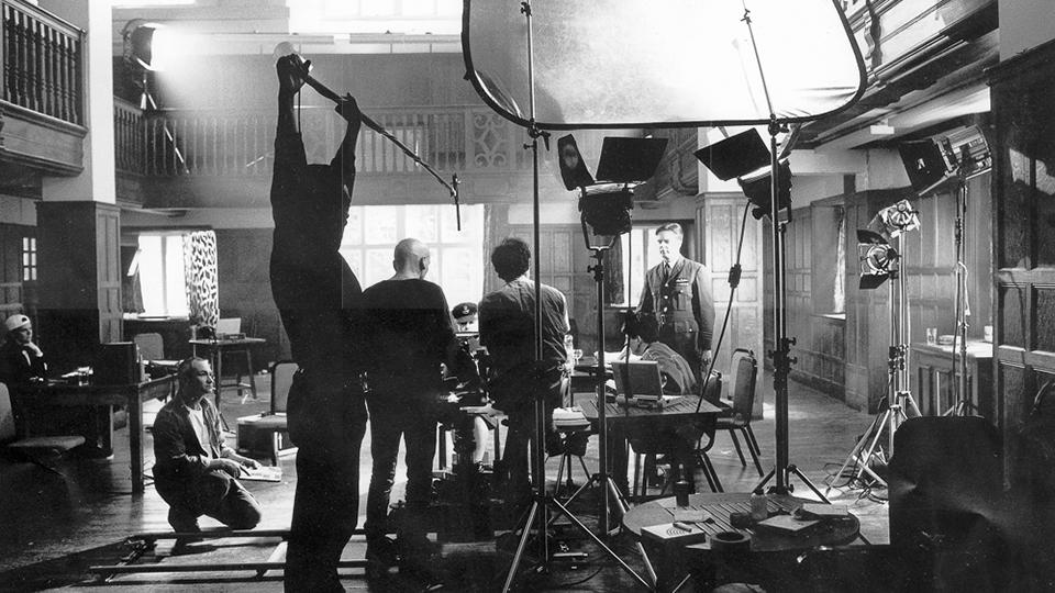 Still of camera crew on a film set