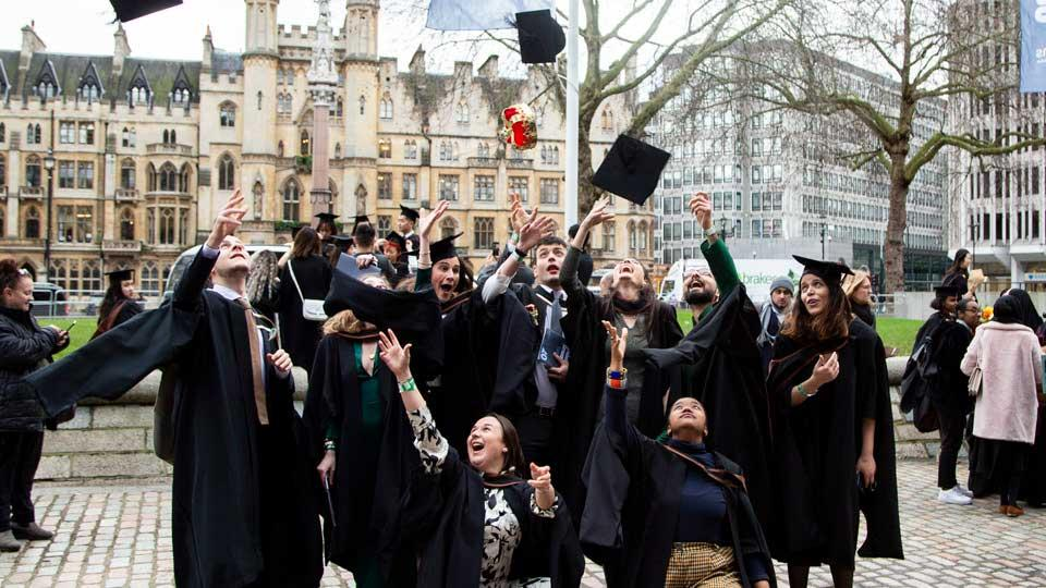 Students celebrate their graduation outside QEII Centre in Westminster