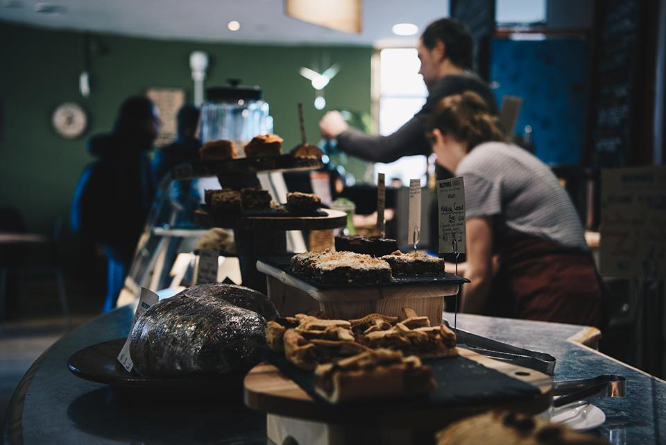 Cakes on the counter of one of New Cross's cafes