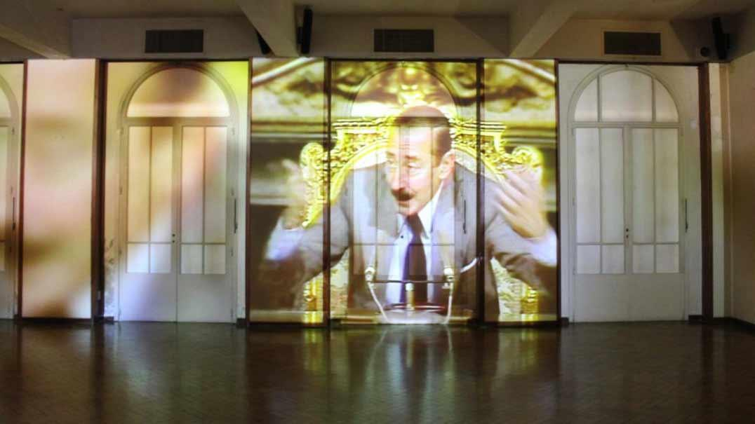 Argentinian dictator Jorge Rafael Videla projected onto a wall of the ESMA Casino building. Vikki Bell 2015.
