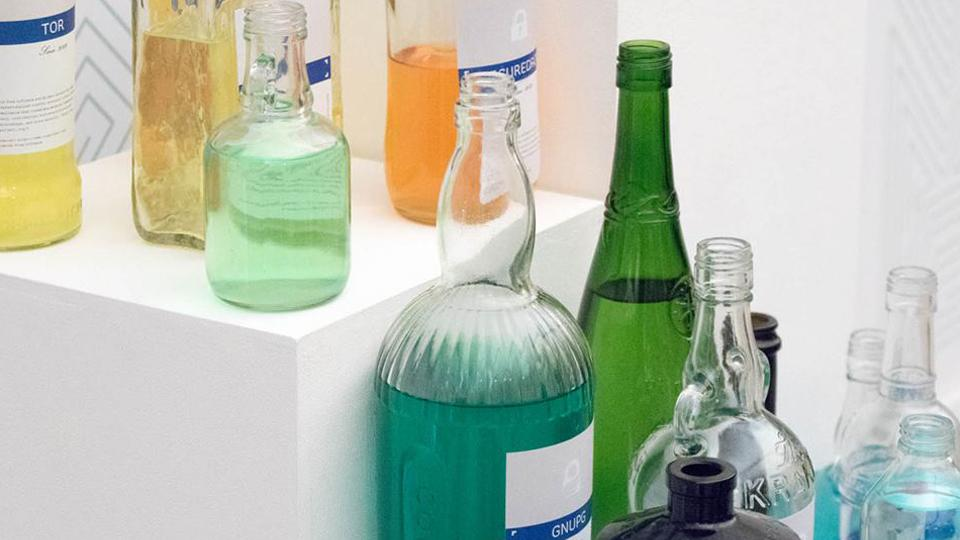 Green bottles standing on a white box